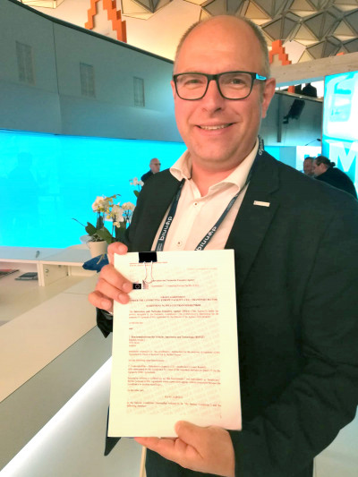 Martin Böhm, leader of the business unit mobility technologies and mobility services holding a contract